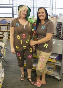 Two teachers dressed up as coconut trees.