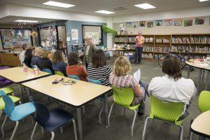 teachers meet in the library