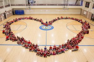 Students form shape of heart.